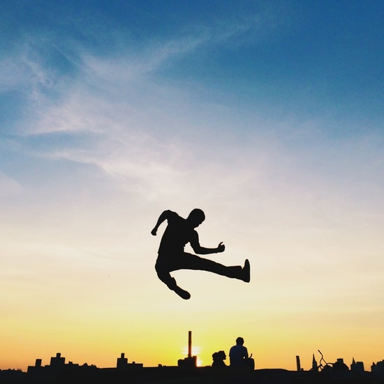 sunset-silhouette-jump-aundre-larrow-large